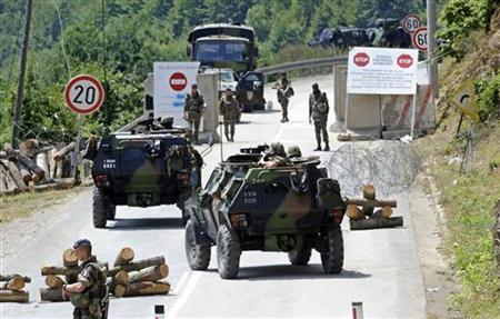 France's KFOR soldiers control the road near the Serbia-Kosovo border crossing in Brnjak